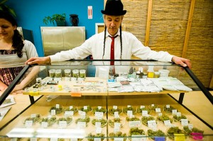 Steve DeAngelo, Executive Director of Harborside Health Center, Oakland's largest medical marijuana dispensary, looks over a marijuana display case at checkout.