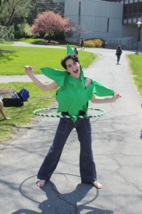 A student volunteer wearing a hemp leaf costume made by another volunteer at Hempstravaganza