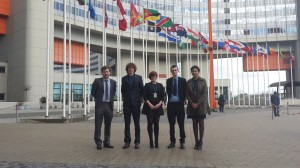 SSDP Ireland and UK standing under the UN Member State flags.  From left to right: Connor Kilgallen, Graham de Barra, Cliodhna Bairead, Ciaran Maher, Ayesha Mian