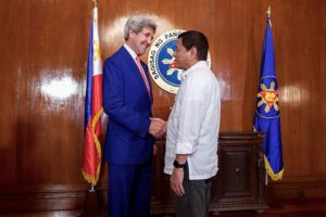 Secretary Kerry Shakes Hands With Philippines President Duterte