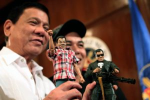 THE SIMPLE AND THE PUNISHER. President Rodrigo R. Duterte poses with toy maker Dennis Mendoza while showing two custom-made action figures of himself. One shows the simple Duterte who is often seen wearing a checkered polo and denim jeans while the other shows the resemblance of the cartoon character 'The Punisher' as he has been known to have an iron fist approach in addressing criminalities. ROBINSON NIÑAL/PPD