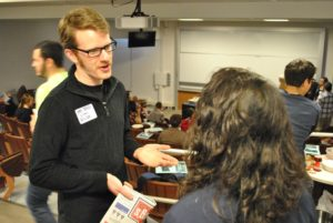 SSDP Alum Sam Tracy speaking with a student