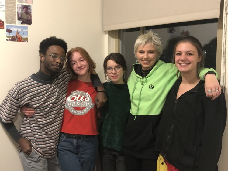 5 members of Middlebury College standing together and smiling. What a nice chapter!