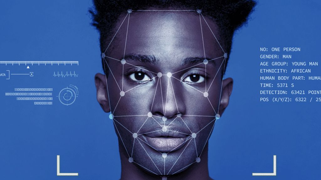 A facial recognition overlay is seen on a black man's face. Facial recognition technology has been shown to confuse non-white faces, leading to arrests of innocent people due to racism in the creation of facial recognition tech.