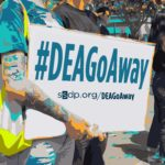 Photo of protester with #deagoaway sign